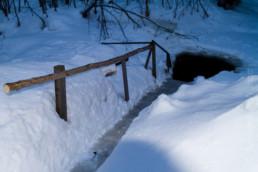 Alex Wünsch Naturfotografie Finnland Winter Schnee Eisloch
